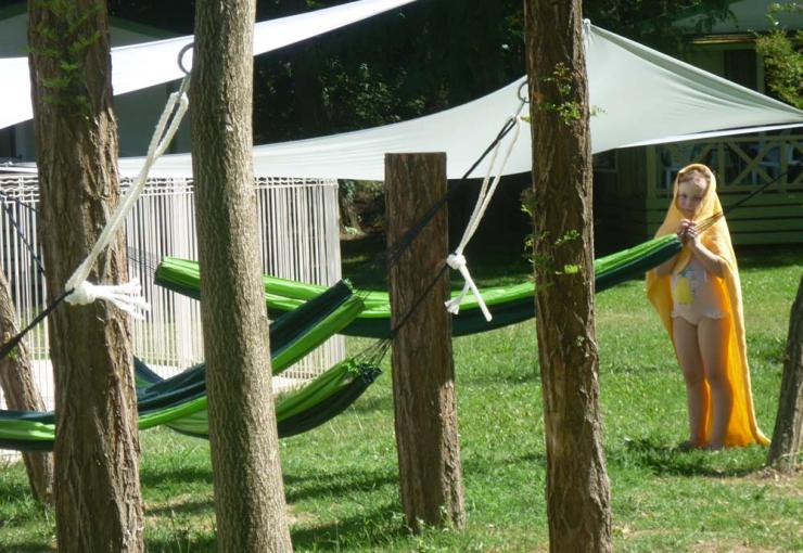 hammocks next to the swimming pool